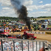SAM HOUSEHOLDER | THE GOSHEN NEWS<br /> A tractor takes off down the track Thursday during the Lucas Oil Pro Pulling League at the Elkhart County 4-H Fair.