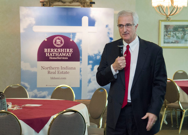 Berkshire Hathaway Home Services Northern Indiana broker owner and CEO Steve Fase speaks at a launch event for the newly-named franchise Tuesday at Elcona Country Club. The franchise's new yard sign and logo is seen in the background.