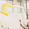 Freshman Kara Pollock twirls her flag in the air during winter guard rehearsal Thursday at Prairieview Elementary School.
