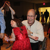 Lillian Woods, 9, enjoys a dance with her grandpa, Keith Julien, at the Daddy-Daughter Dance Friday at Grace Community Church in Goshen.