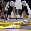 The Goshen High School Winter Guard jumps during their rehearsal Thursday at Prairieview Elementary School in Goshen.