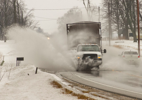 A truck splashes through standing water on U.S. 6 outside of Nappanee Thursday. Standing water was an issue around the area as melting snow and heavy rain combined to cause drainage issues.