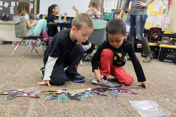 JULIE CROTHERS | THE GOSHEN NEWS<br /> kindergarten classmates Gabriel Hershberger, 5, left, and Juliouz Perez, 5, play a Thanksgiving matching game Tuesday at Parkside Elementary School.