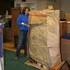 SHEILA SELMAN | THE GOSHEN NEWS<br /> Dawn Woods and friend Jana Foust package a portrait of Burt Reynolds for shipping.