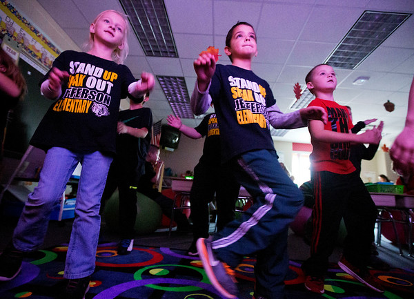 JAY YOUNG | THE GOSHEN NEWS<br /> Jefferson Elementary first grade students, from left, Callie Miller, 7, Caleb Hicks, 7, and Jace Gist, 6, practice their ninja moves during a PAX game on Monday afternoon. PAX is a program used at the school to teach students good behavior and self-control.  The game the students are playing as a reward for good behavior during reading time.