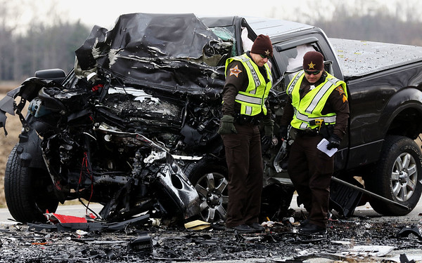 JAY YOUNG   THE GOSHEN NEWS<br /> Officers from the Elkhart County Sheriff's Department work the scene of a fatality collision involving a pickup truck and semi-truck on Friday morning on U.S. 6 near the intersection of CR 123, south of New Paris.