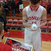 "DAVID VANTRESS | THE GOSHEN NEWS<br /> GOSHEN'S DERIC HAYNES signs an autograph for a young fan after a game against South Bend St. Joseph Tuesday night. Goshen travels to West Noble tonight to close out the 2013-14 regular season. - See more at: <a href=""http://www.goshennews.com/localsports/x1196464118/IN-A-GOOD-PLACE#sthash.Bl5xIB8g.dpuf"">http://www.goshennews.com/localsports/x1196464118/IN-A-GOOD-PLACE#sthash.Bl5xIB8g.dpuf</a>"