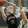SAM HOUSEHOLDER   THE GOSHEN NEWS<br /> NorthWood senior Will Stueve shoots over a Penn player during the game Tuesday at Penn High School.