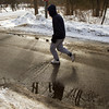 SAM HOUSEHOLDER | THE GOSHEN NEWS<br /> Levon Yoder jogs down Gra Roy Drive in Goshen Friday near the millrace. Yoder said that he jogs about two miles every day and that he doesn't mind the cold as long as he's dressed warm. With more snow in the forecast for the weekend the winter weather will not be going away anytime soon.