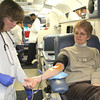 SHERRY VAN ARSDALL | THE GOSHEN NEWS<br /> At left, Debbie Seafolk, a tech with the American Red Cross, keeps watch as Sherry Riedel of Elkhart donated blood at Faith United Methodist Church in Goshen. The severe winter weather has caused cancellations of blood drives and created a shortage of blood and platelet donations.