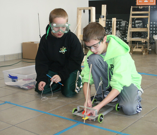 "SCOTT WEISSER | The Goshen News<br /> Northridge Middle School students Nick Taylor, right, and Adam Simons ready their entry in the ""Wheeled Vehicle"" competition Saturday during the Regional Science Olympiad at Goshen College. Following Saturday's regional contest, a Northridge Middle School team is set to advance to state-level competition."