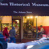 SAM HOUSEHOLDER | THE GOSHEN NEWS<br /> People walk past the Goshen Historical Museum as the band Waterbound plays inside during First Friday Sweet Indulgence. The event featured several businesses running specials and a movie screening at The Art House.