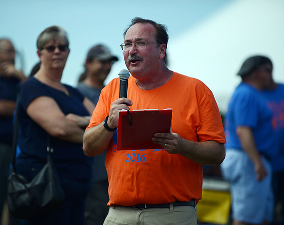HALEY WARD | THE GOSHEN NEWS<br /> Bill Reith, president and CEO of the United Way of Elkhart County, talks during the Great Cardboard Boat Race Friday.