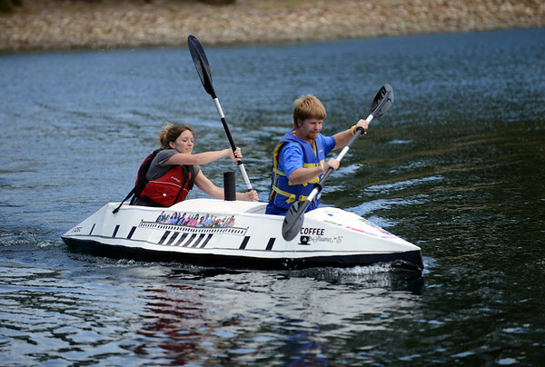 HALEY WARD | THE GOSHEN NEWS<br /> Ashley Martin, art team leader at ADEC, and Tim Nessley, an ADEC client, compete in the Great Cardboard Boat Race, hosted by United Way of Elkhart County Friday. ADEC won the past four events but did not win this year.