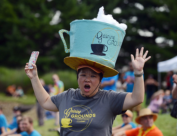 HALEY WARD | THE GOSHEN NEWS<br /> Jessica Koscher, chief development officer for ADEC, cheers on the ADEC team during the final race Friday at the Great Cardboard Boat Race, hosted by United Way of Elkhart County. ADEC clients made her hat, the boat, and one competed in the race.