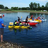 HALEY WARD | THE GOSHEN NEWS<br /> The championship race starts Friday at the Great Cardboard Boat Race, hosted by United Way of Elkhart County. The IU Health team in the red boat won.