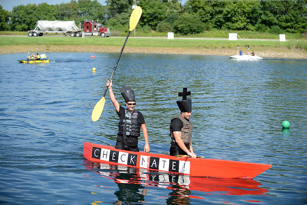 HALEY WARD   THE GOSHEN NEWS<br /> Ron Haskins and Jared Berkey celebrate as they win the Great Cardboard Boat Race, hosted by United Way of Elkhart County Friday. The event kicked off United Way's annual fundraising campaign. The race was held at LaSalle Bristol along C.R. 17 in Elkhart.