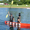HALEY WARD | THE GOSHEN NEWS<br /> Ron Haskins and Jared Berkey celebrate as they win the Great Cardboard Boat Race, hosted by United Way of Elkhart County Friday. The event kicked off United Way's annual fundraising campaign. The race was held at LaSalle Bristol along C.R. 17 in Elkhart.