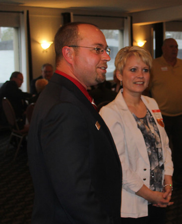 DANIEL RIORDAN | THE GOSHEN NEWS District 22 State Representative Republican candidate Curt Nisly, left, with his wife Mary, talks to Joe Pellman Thursday night in Warsaw.