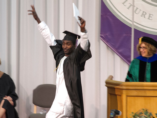 SAM HOUSEHOLDER | THE GOSHEN NEWS<br /> Sunday Gabriel Mahaja celebrates having received his diploma during the Goshen College commencement ceremony Sunday.