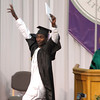 SAM HOUSEHOLDER | THE GOSHEN NEWS<br /> Sunday Gabriel Mahaja celebrates having received his diploma during the Goshen College commencement ceremony Sunday.