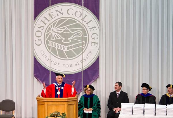 SAM HOUSEHOLDER | THE GOSHEN NEWS<br /> Goshen College president Jim Brenneman addresses the graduates during the 116th Goshen College Commencement ceremony Sunday.