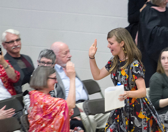 SAM HOUSEHOLDER | THE GOSHEN NEWS<br /> Sara Klassen high fives her mother, Mary, after recieving her diploma at the Goshen College commencement ceremony Sunday.