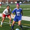 GREG KEIM | THE GOSHEN NEWS<br /> Ashton Ellis of Goshen marks Carroll junior Amber Hoot, No. 22, duringt the Class 2A high school girls soccer semistate Saturday at South Bend St. Joseph. Carroll was a 1-0 winner.