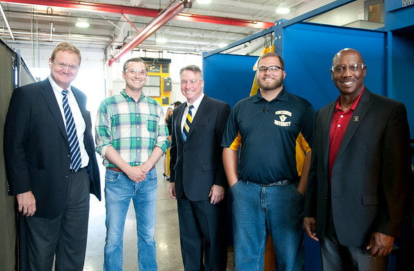 HALEY WARD | THE GOSHEN NEWS<br /> David Tucker, Vice President of Workforce Development; Matt Moreland, General Manager of Lippert; Charles Johnson, President of Vincennes University; instructor Cole Warner and Eric Holloway, President of MBC Staffing, stand on the floor by the welding booths during the graduation ceremony of their first welding class Tuesday at Lippert Components.