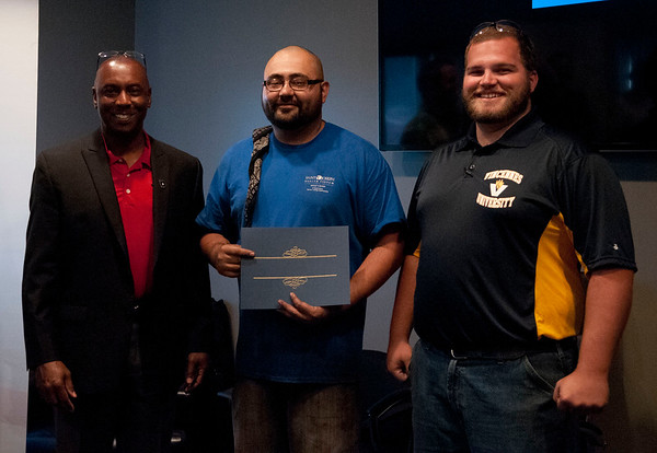 HALEY WARD | THE GOSHEN NEWS<br /> Eric Holloway, president of MBC Staffing, Elmer Garcia, Chicago, and instructor Cole Warner during the graduation ceremony of their first welding class Tuesday at Lippert Components.