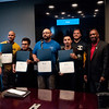 HALEY WARD | THE GOSHEN NEWS<br /> Matt Moreland, General Manager of Lippert, RV Boles, Armando Celestino, Elmer Garcia, Jyhonathan Perez Paulino, instructor Cole Warner, Eric Holloway, President of MBC Staffing, and Charles Johnson, president of Vincennes University, pose with their certificates following the graduation ceremony of their first welding class Tuesday at Lippert Components. The program was a partnership with Lippert MBC Staffing and Vincennes University. The program lasted six to eight weeks, and students received a hands on training. They first learned to weld in the booth, then spent time on the training line and in the shop working with the other employees at Lippert.
