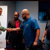 HALEY WARD | THE GOSHEN NEWS<br /> Matt Moreland, General Manager of Lippert, shakes hands with Elmer Garcia, Chicago, while Garcia receives his diploma as Eric Holloway, president of MBC Staffing, and instructor Cole Warner watch during the graduation ceremony Tuesday at Lippert Components. The program was a partnership with Lippert MBC Staffing and Vincennes University. The program lasted six to eight weeks, and students received a hands on training.
