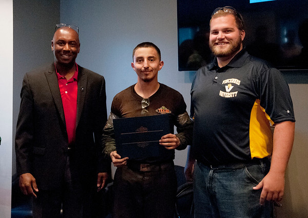 HALEY WARD | THE GOSHEN NEWS<br /> Eric Holloway, president of MBC Staffing, Jyhonathan Perez Paulino, South Bend, and instructor Cole Warner during the graduation ceremony of their first welding class Tuesday at Lippert Components.