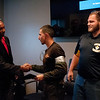 HALEY WARD | THE GOSHEN NEWS<br /> Jyhonathan Perez Paulino shakes hands with Eric Holloway, president of MBC Staffing, after receiving his certificate from instructor Cole Warner during the graduation ceremony of their first welding class Tuesday at Lippert Components. The program was a partnership with Lippert MBC Staffing and Vincennes University. The program lasted six to eight weeks, and students received a hands on training. They first learned to weld in the booth, then spent time on the training line and in the shop working with the other employees at Lippert.