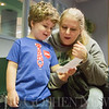 JAY YOUNG | THE GOSHEN NEWS<br /> Four-year-old Layne Miller sings a song with his mom, Jennifer Lawhorn, of Goshen, during Storytime at the Goshen Public Library on Wednesday morning.