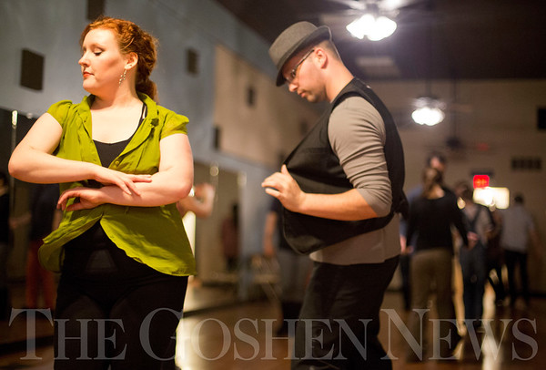 JAY YOUNG   THE GOSHEN NEWS<br /> Katie Brenneman, of Elkhart, spins away from dance partner Matt Smith, of South Bend, as the duo dances West Coast Swing style at Go Dance Studio on Thursday evening.
