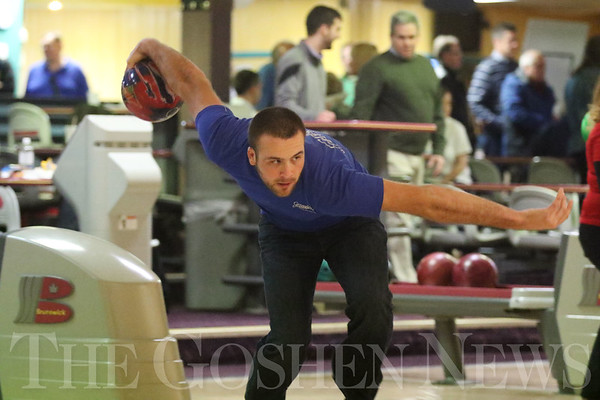 JAY YOUNG | THE GOSHEN NEWS<br /> Steve Eiermann takes aim down the alley during the ninth annual Spare Time at the Chamber bowling event on Thursday afternoon at Maple City Bowling.  Eiermann was representing Greenfield Landscaping. Twenty teams made up of five bowlers each took part in the event hosted by the Goshen Chamber of Commerce.