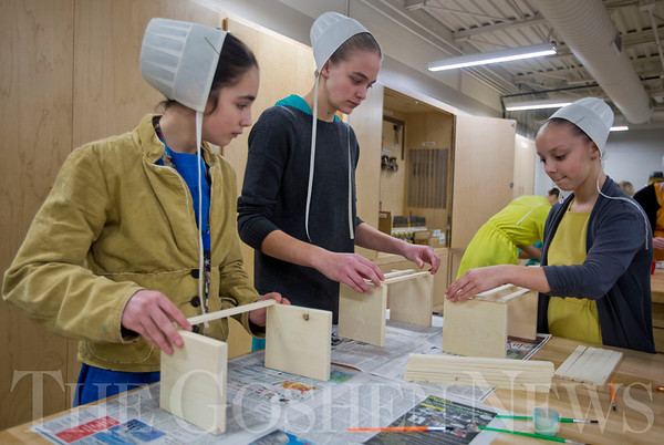 JAY YOUNG | THE GOSHEN NEWS<br /> Seventh graders at Millersburg Elementary, from left, Zara Miller, Miranda Miller and Kari Miller work on building wooden crates during a shop class on Wednesday afternoon.