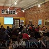 PHOTO SUBMITTED<br /> Julia Schmidt, a Goshen resident researching the possibility of establishing a new immigrant resource center in Elkhart County, speaks to a large group of people during a meeting to discuss her plans at the Civic Salon in Goshen Jan. 10.