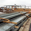 Roger Schneider | The Goshen News<br /> A pile of steel girders rests in front of an industrial building that is being constructed at 1755 Ardmore Court on Goshen's south side. The building is being built by Hoogenboom-Nofziger as part of the company's development of its industrial park along Dierdorff Road.