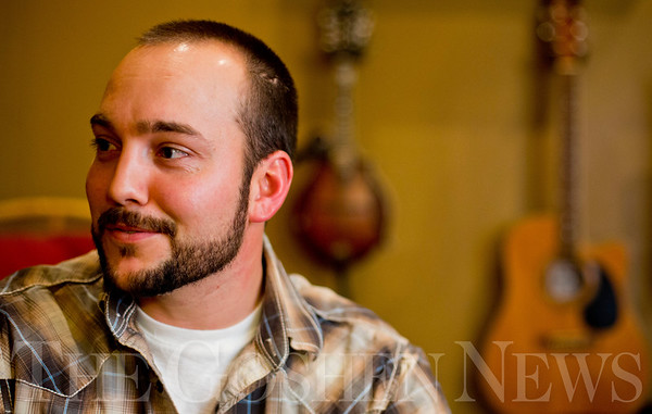 JAY YOUNG | THE GOSHEN NEWS<br /> Aaron Stutzman talks about how he became interested in yodeling Wednesday evening in his home in Millersburg.