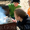 SHERRY VAN ARSDALL | THE GOSHEN NEWS<br /> Kaleb Eberle of Troop 4 of Wakarusa tries to keep a fire going during a first aid activity during the Klondike Derby at Ox Bow County Park Saturday. There were 100 Boy Scouts from Pioneer Trails District of LaSalle Council in Elkhart County and Cass County in Michigan.