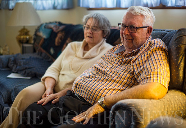 JAY YOUNG | THE GOSHEN NEWS<br /> As his wife Joy holds his hand, Don Chesher flashes a quick smile as he reminisces about his past 32 years as a pastor at Faith Baptist Church of Middlebury while they sit on the couch in their home on Wednesday afternoon.