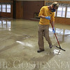 Roger Schneider | The Goshen News<br /> Aaron Miller of Ideal Coatings, clean the floor in the Sunnyside Park Pavilion in New Paris. The pavilion is undergoing a facelift and will have a new floor by next week to go along with a new ceiling installed several months ago.