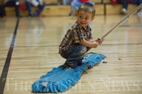 JAY YOUNG | THE GOSHEN NEWS<br /> Two-year-old Tucker Long holds on tight as he rides across the basketball court on a broom as his dad Jed sweeps the floor during halftime of Elkhart Christian Academy's home basketball game against Goshen High on Tuesday night in Elkhart. Jed is the Athletic director of ECA.