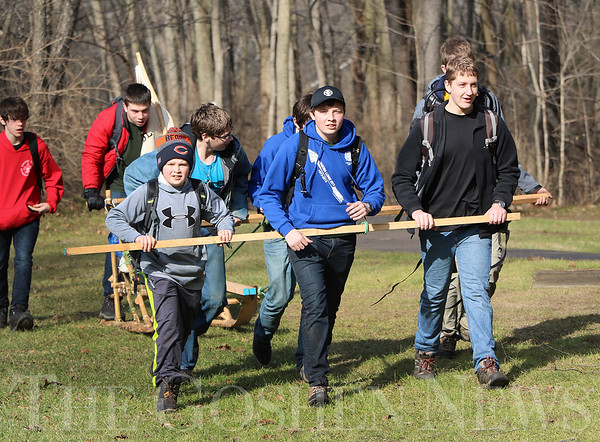 SHERRY VAN ARSDALL | THE GOSHEN NEWS<br /> Scouts from Troop 593 of Edwardsburg, Michigan, devised a unique way to pull their dog sled  during the Klondike Derby at Ox Bow County Park Saturday. There were 100 Boy Scouts from Pioneer Trails District of LaSalle Council in Elkhart County and Cass County in Michigan.
