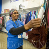 JAY YOUNG | THE GOSHEN NEWS<br /> Glenda Jackson arranges purses for sale at the Goodwill store located at   3808 East Mishawaka Road on Thursday afternoon. The store recently opened in November, replacing the older Goodwill store that sat just north of the new location along South Main Street. The new store provides nearly double the space of the older space, along with a career center and drive-thru donation drop-off area.
