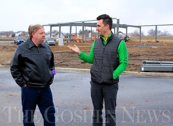 Roger Schneider | The Goshen News<br /> Goshen Mayor Jeremy Stutsman, right, talks to Greg Hoogenboom Thursday about the industrial building Hoogenboom is having constructed behind them at 1755 Ardmore Court.