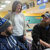 JAY YOUNG | THE GOSHEN NEWS<br /> Leah Hunsberger, representing Accurity, has a laugh with Jesse Sensenig, left, and Justin Ramer, both representing Goshen Brewing Company, during the ninth annual Spare Time at the Chamber bowling event on Thursday afternoon at Maple City Bowling.  Twenty teams made up of five bowlers each took part in the event hosted by the Goshen Chamber of Commerce.