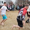 JAY YOUNG | THE GOSHEN NEWS<br /> Participants in the Polar Plunge charge into the cold water of Wawasee Lake at the Oakwood Resort during Wawasee Winter Carnival on Saturday in Syracuse.  Nine people took part in the plunge that benefitted Boomerang Backpacks.